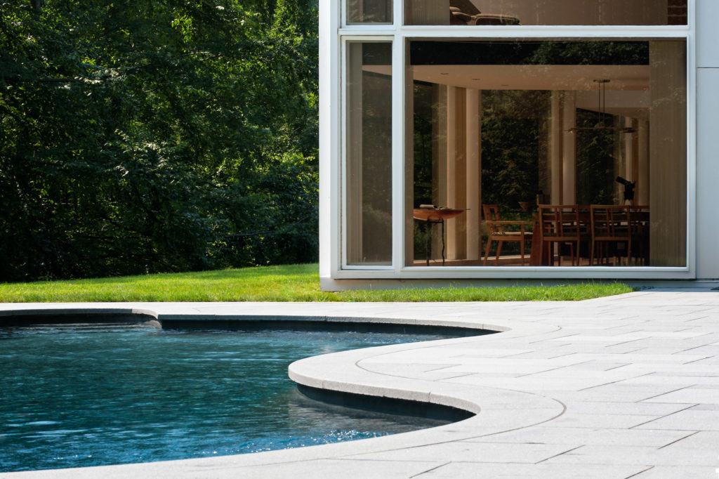 Modern glass house pool