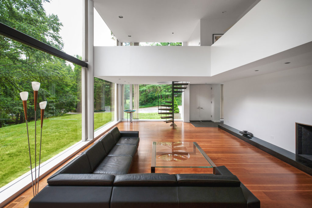 Interior living space mid-century modern glass house