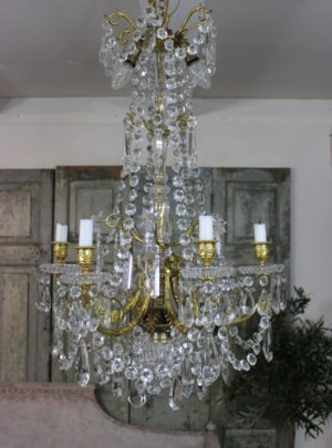 Beautiful Swedish empire style prism chandelier from the late 19th century partly veiled.