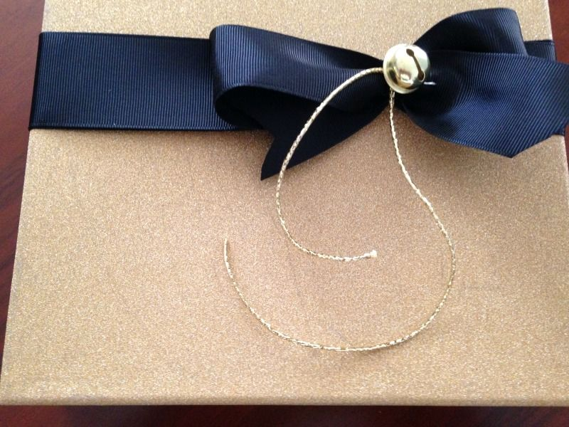 Gold glitter paper, black bow