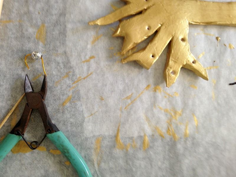 Silver ornaments on gold clay christmas tree