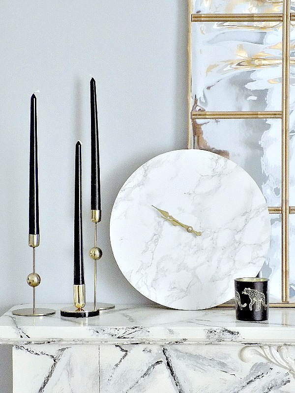 Faux marble clock on faux marble mantel