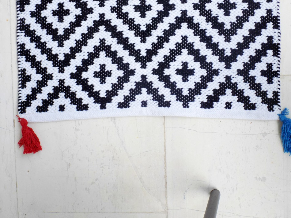 Outdoor black and white rug with tassels