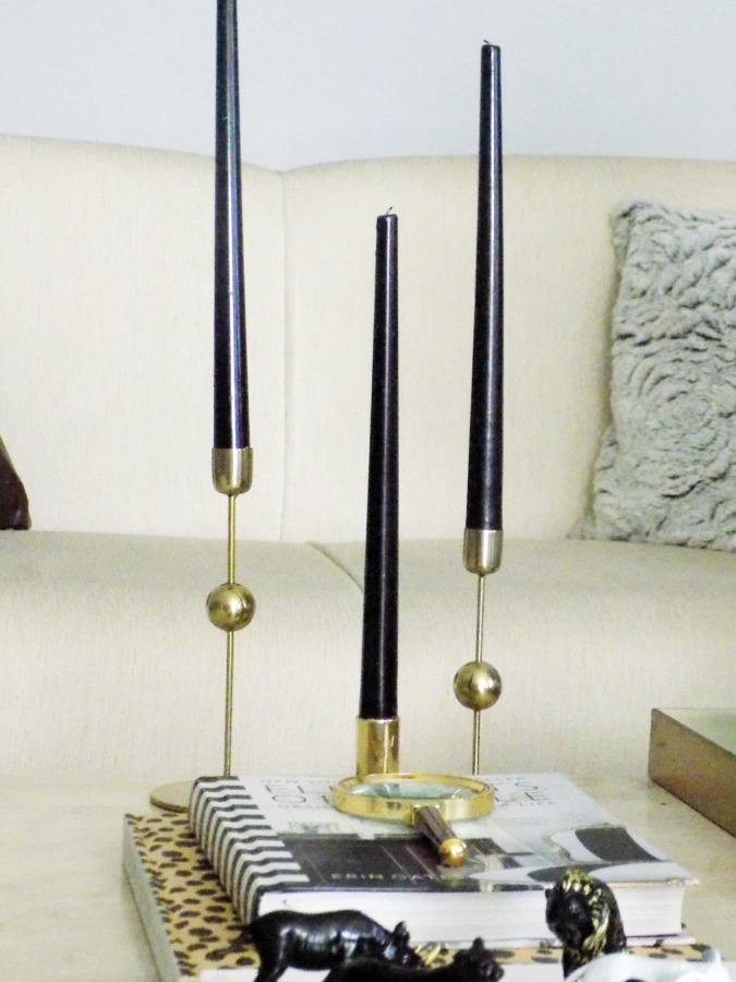Brass candle holders, black candles
