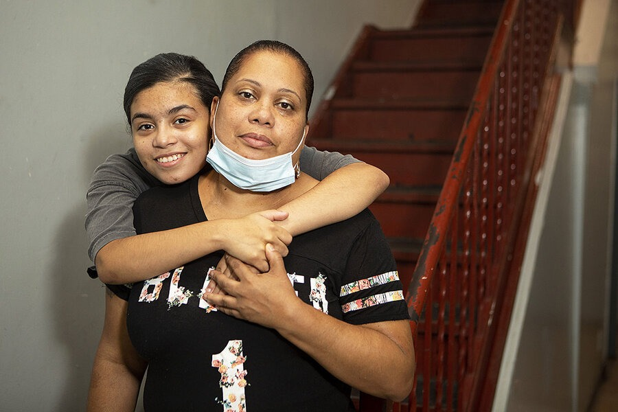 Formerly homeless, Rosa Febo and her daughter, Melanie Bergos, pose in the hallway of the building where they recently got a subsidized apartment, Oct. 5, 2020, in the New York City neighborhood of Harlem. Melanie is learning remotely, but Ms. Febo worries about the internet being shut off due to unpaid bills. Melanie Stetson Freeman/The Christian Science Monitor