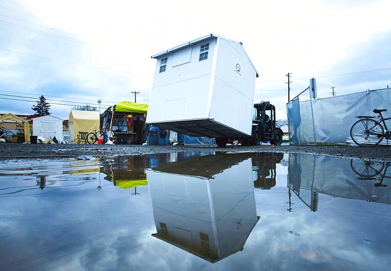 Pallet Shelters, an Everett, Washington-based company that has developed a prefab tiny homes built with rot-resistant plastic composite walls and floors, makes the 64- or 100-square-foot pods.