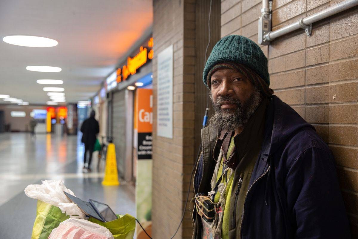 """""""Kush"""" says he sometimes spends time in Penn Station to recharge his electronics and listen to music, Jan. 5, 2020. Ben Fractenberg/THE CITY"""