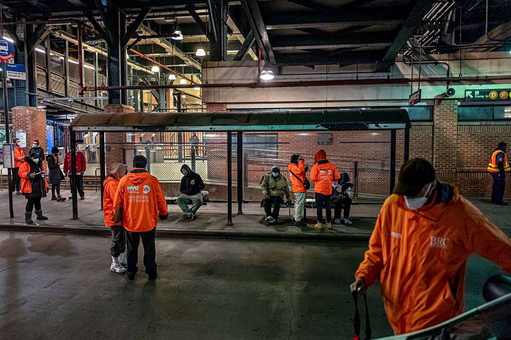 Outreach workers at the Stillwell Avenue Station in Brooklyn offer to take homeless people to shelters when the subway shuts down each night. Jonah Markowitz for The New York Times