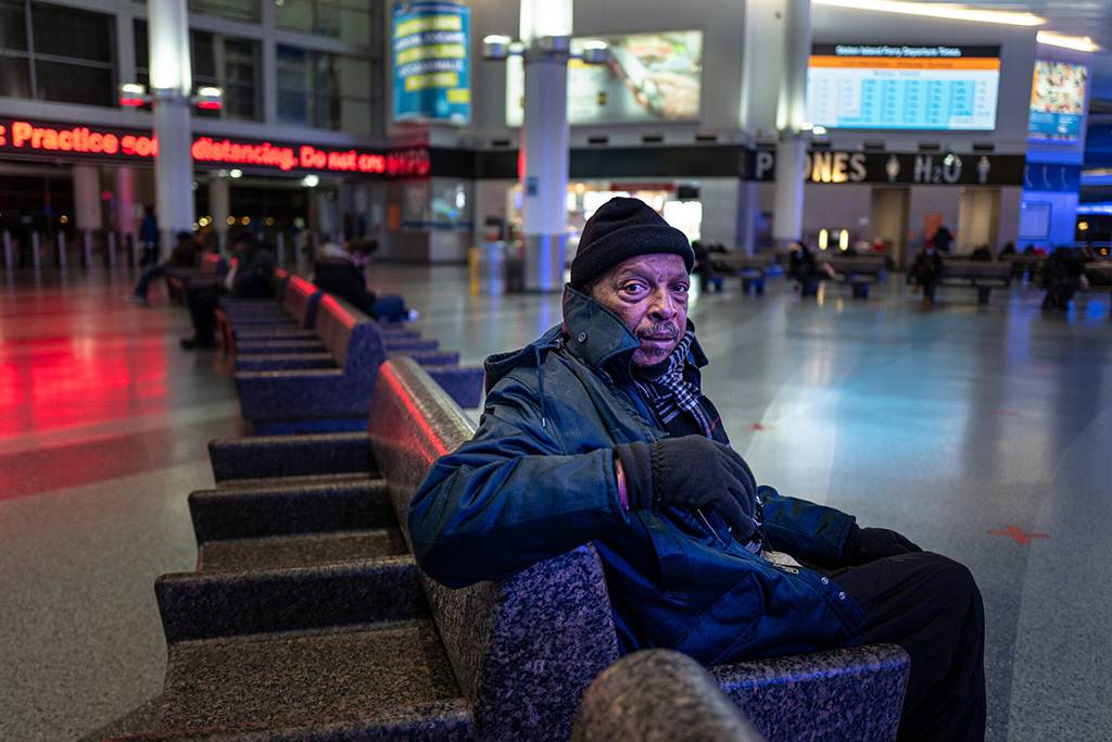 """""""There is nowhere else to go,"""" said Justin MacDonald, 66, who spends his nights on the Staten Island Ferry because it has continued to operate overnight. Jonah Markowitz for The New York Times"""
