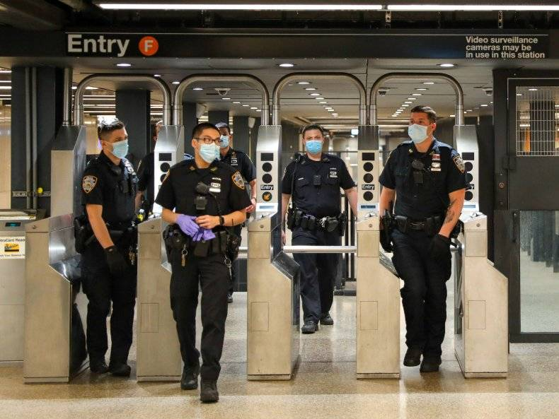 The NYPD will deploy 500 officers to NYC subway stations after a series of fatal stabbings. Here, officers on patrol around Times Square subway station on May 15, 2020 in New York City. JOSE PEREZ/GETTY