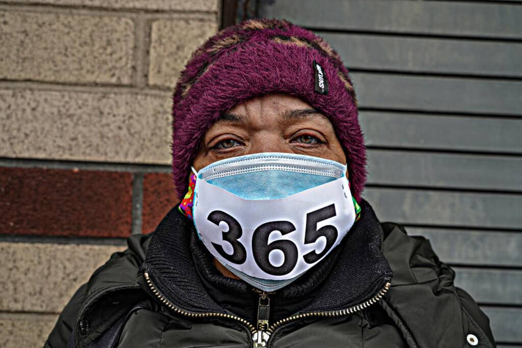 """Homeless shelter security officers and members of Local 32BJ of the Service Employees International Union wore masks with the number """"365"""" to signify their year-long battle against COVID-19. Dean Moses"""