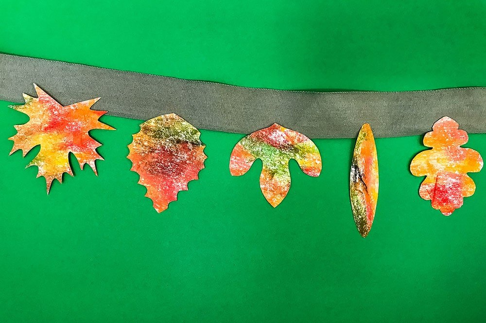An autumn leaf kids printable with 101 uses! We made a coloring page, a leaf art garland, a collector's book and more!