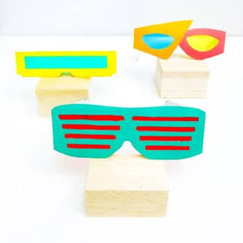 Kids will have a total blast crafting 3 pairs of bodacious 80's-inspired sunglasses out of an upcycled cereal box and paint! Free templates included.