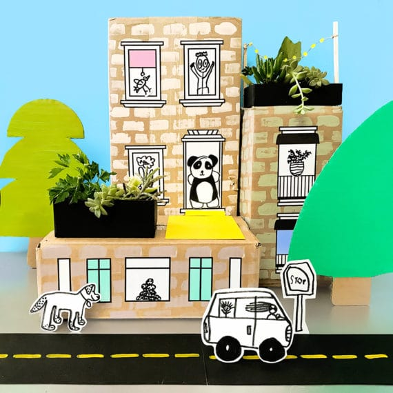 Make a vibrant and colorful art-filled city neighborhood with cardboard boxes! This craft activity for kids incorporates art and imagination for hours of creative play!