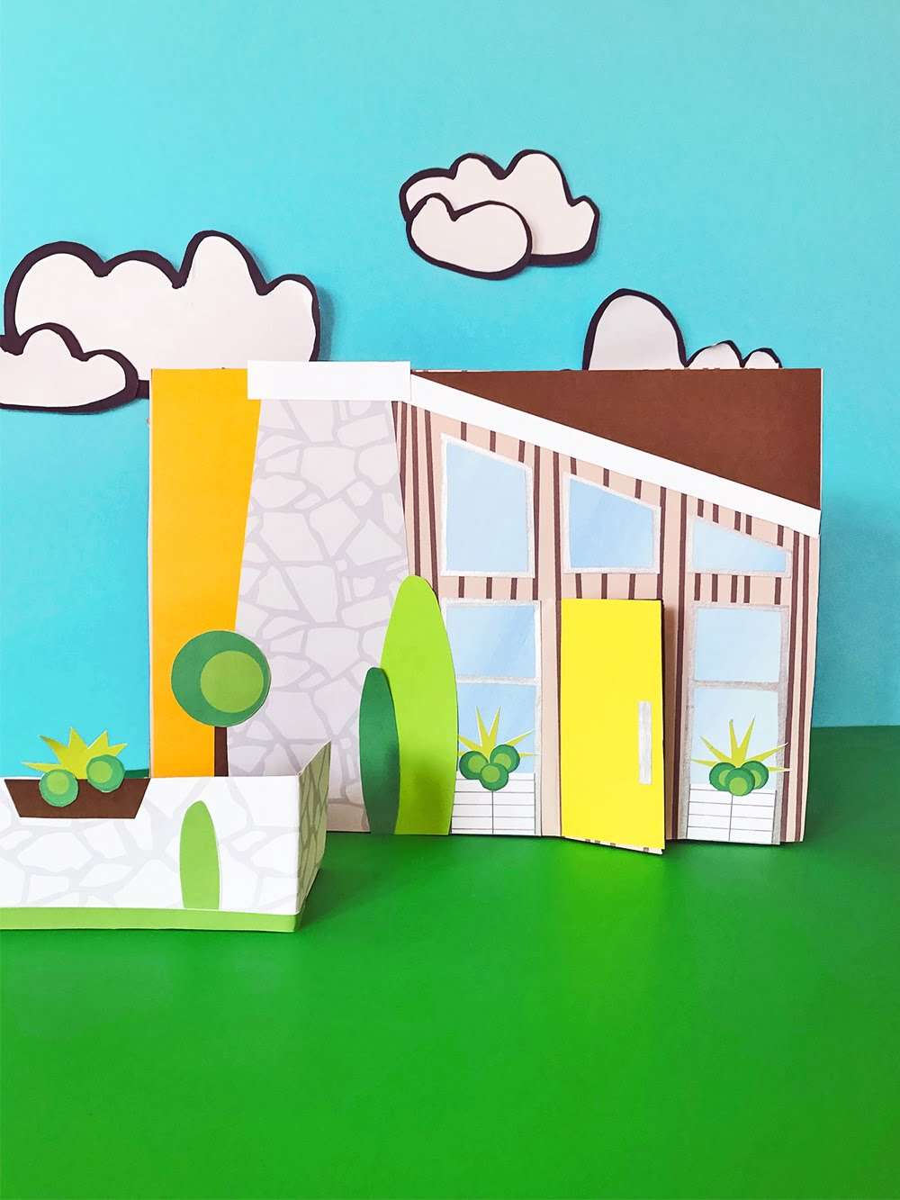 Create your own storybook mid-century modern DIY shoebox house using a cardboard box and collaging textures and simple shapes. A great rainy day activity for kids of any age!