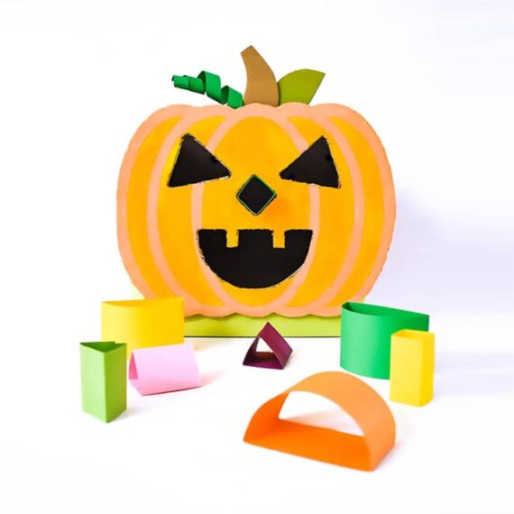 Use cereal boxes to create an adorable DIY upcycled cardboard jack-o-lantern shape sorter (template included)