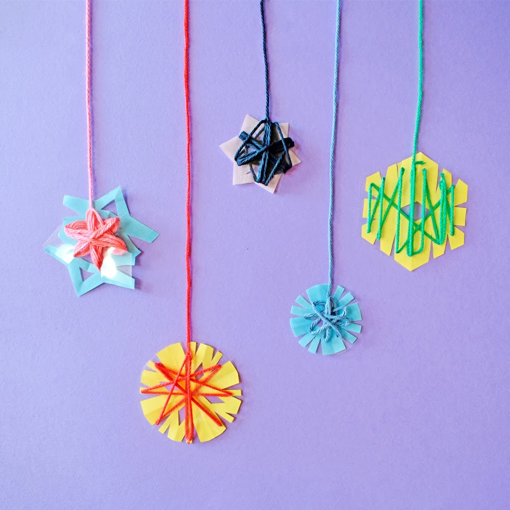 Upcycle plastic containers to make these lovely and simple yarn-wrapped snowflake ornaments!