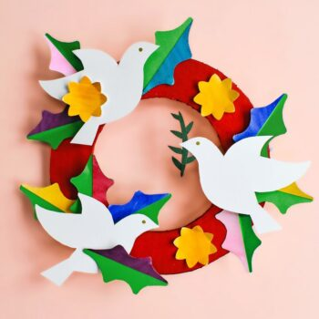 A DIY peace and love paper wreath. Use watercolor washes on our free templates to create this lovely handmade holiday keepsake. | via barley & birch