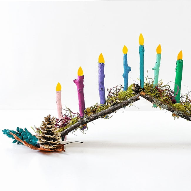 Make a DIY menorah for kids using colorful painted twigs!