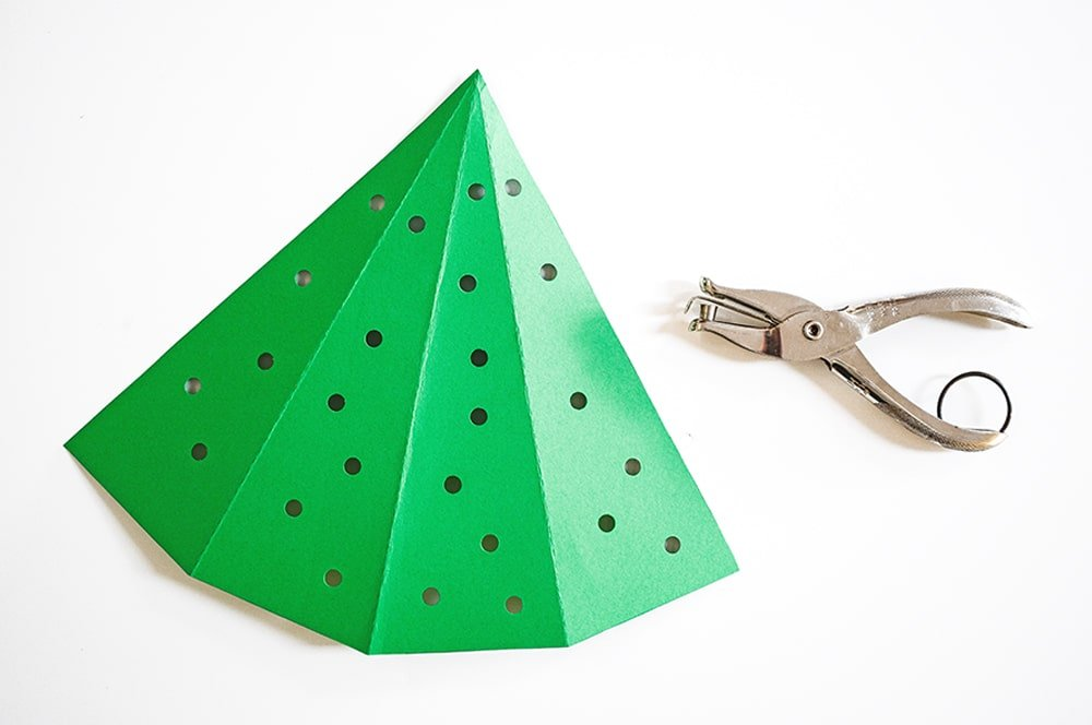 Use a hole punch to make 25 holes in your paper tree