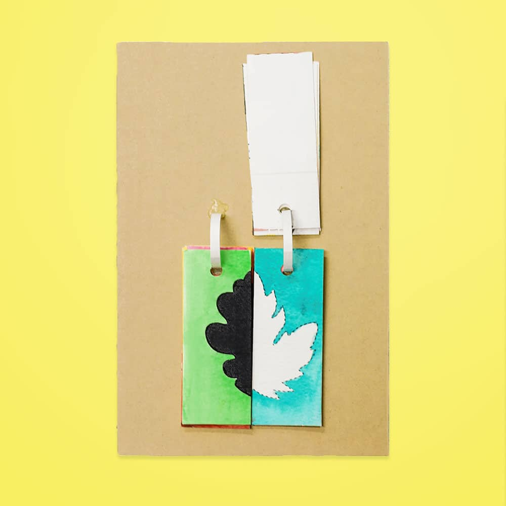 Our cardboard DIY fall leaf match flip book is a fun way for kids to practice shape recognition while learning about positive and negative space. | via barley & birch