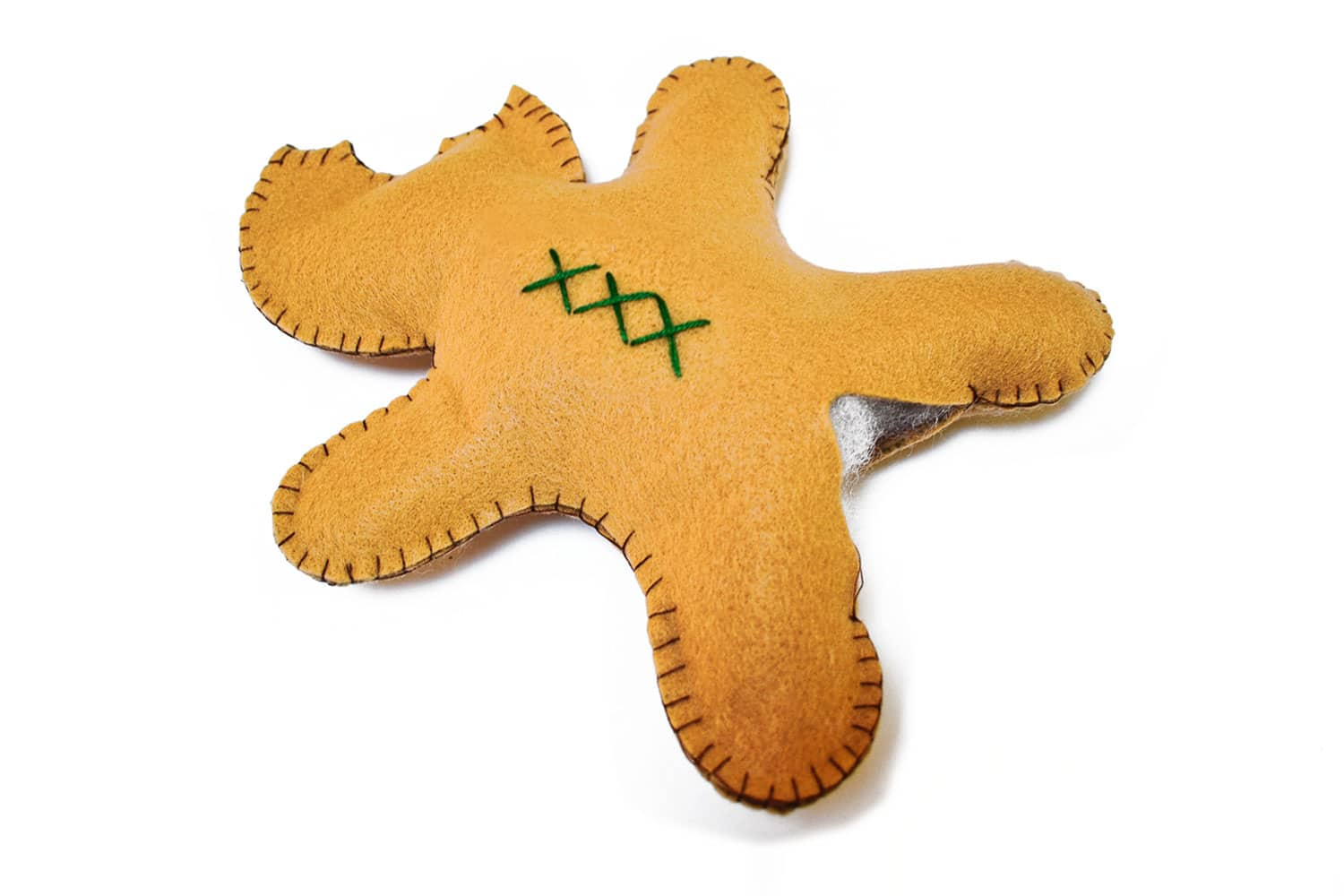 Stuff your gingerbread man softie with polyfill or other stuffing materials then sew closed. | via barley & birch