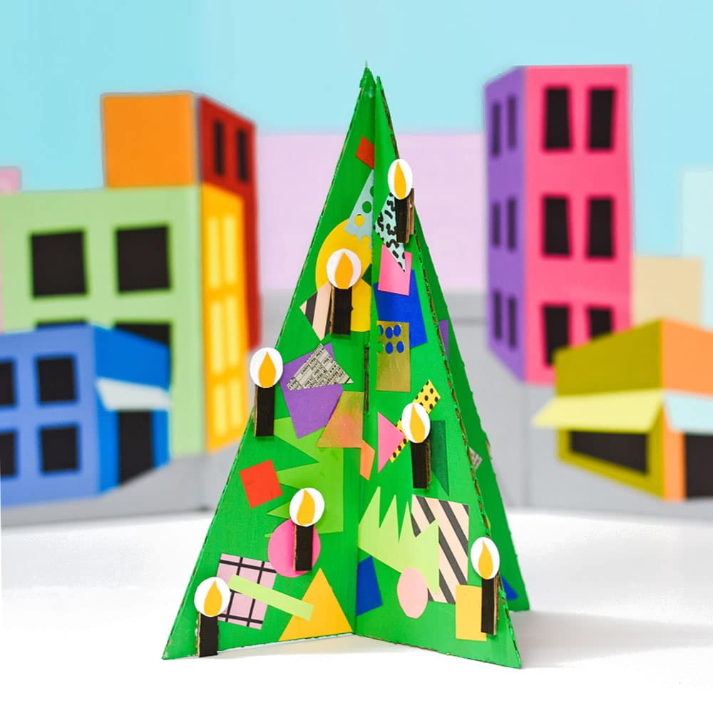 This merry and bright cardboard Christmas tree is a fantastic recycled holiday art project for kids, and a great way to use up scrap paper and wrap! | via barley & birch