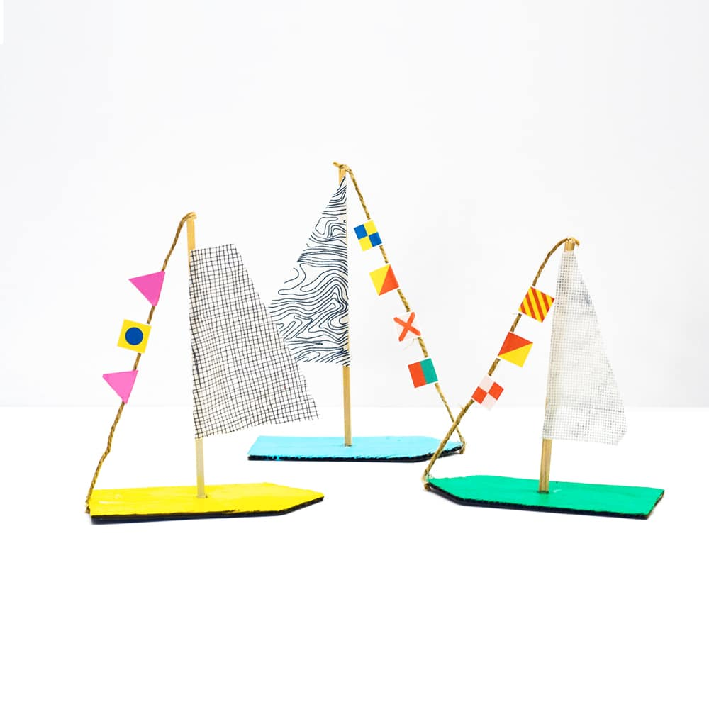 Use simple scrap supplies to make these cardboard secret message sailboats! A visual language exercise and upcycled summer craft for kids. | via barley & birch