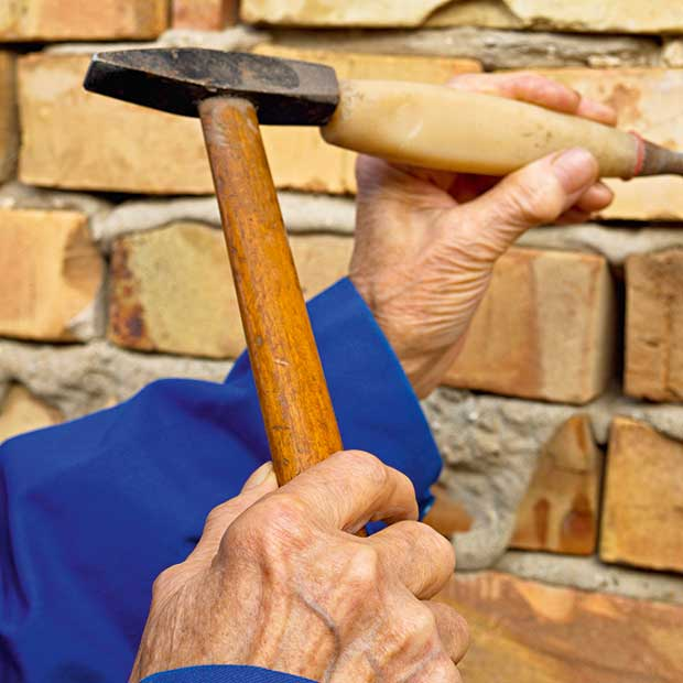 Repairing-Brickwork-Render-Cutting-Out-Defective-Brick