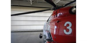 Single leaf aviation hangar door ASSA ABLOY Entrance Systems fire helicopter