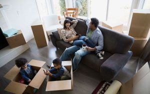 Moving boxes family living room featured
