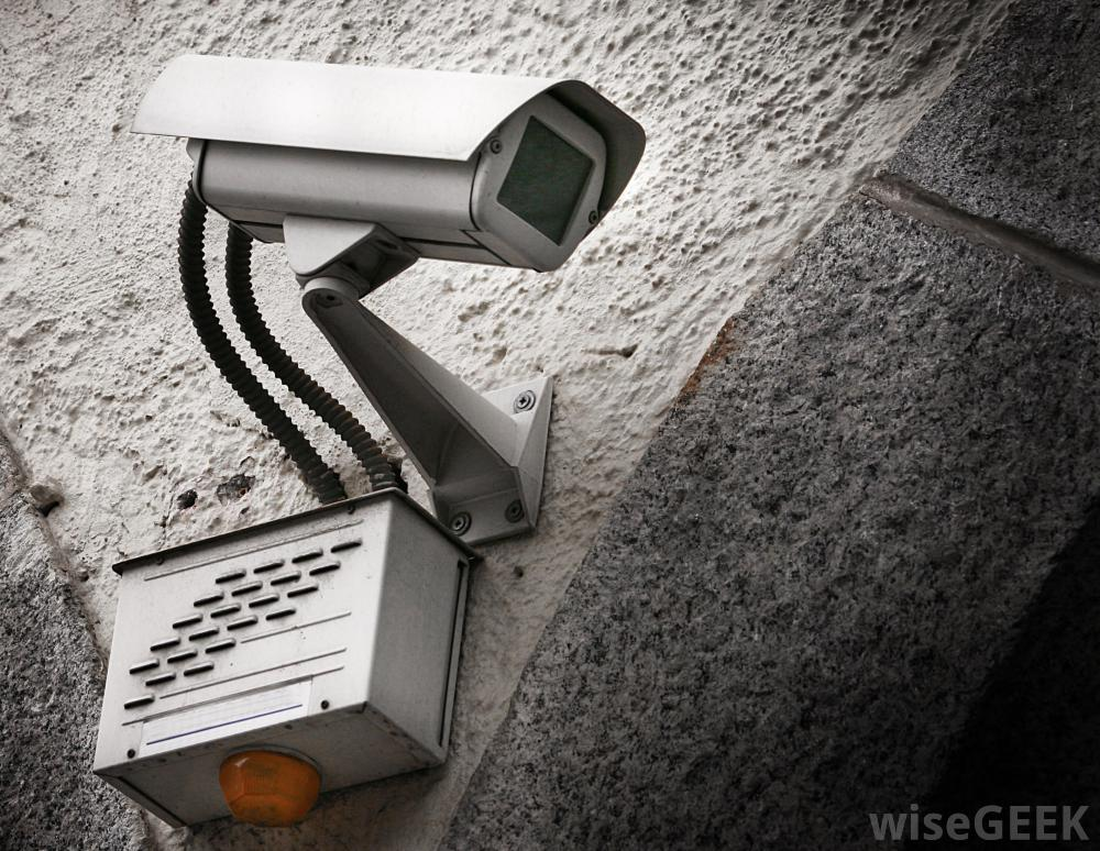 surveillance camera mounted on concrete wall