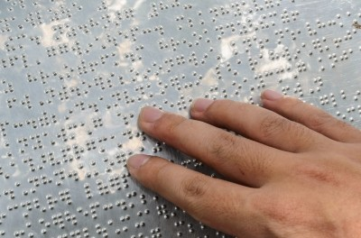 Close Up Hand Reading Braille