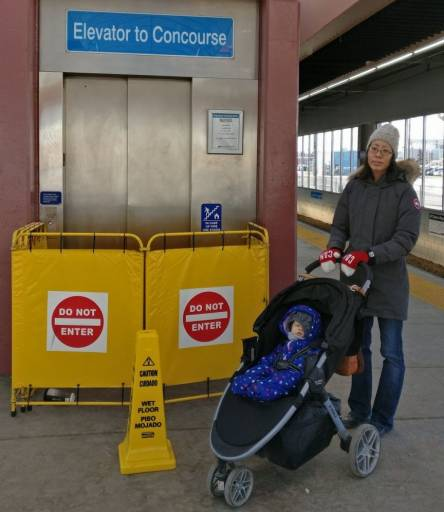 Sharon Yeo with her daughter and stroller in front of the closed elevator at the Stadium LRT station near downtown Edmonton, Alta. on Tuesday, January 29, 2019.