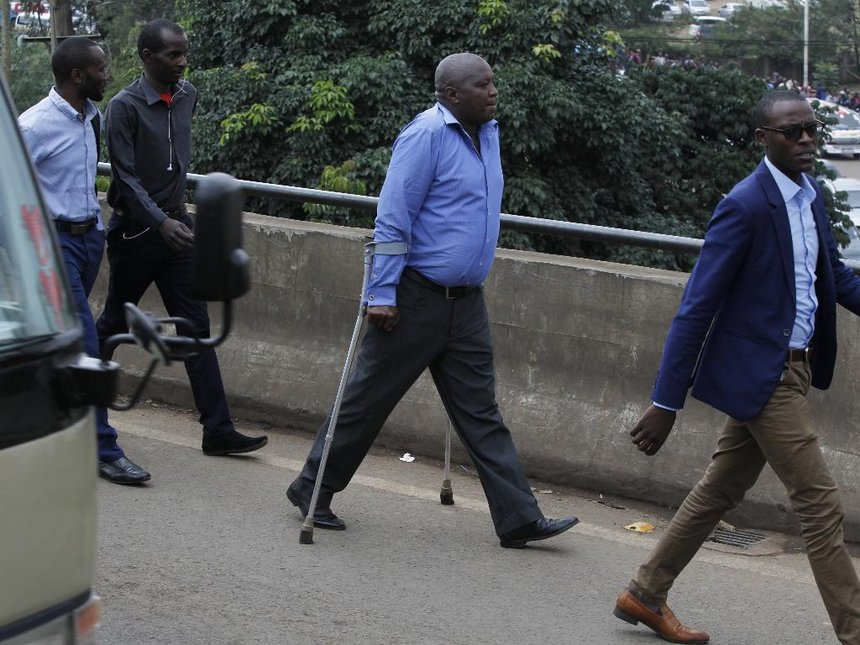 A physically disabled man walks with others to CBD after Nairobi county put to effect the ban of matatus in the CBD / MONICA NJERI