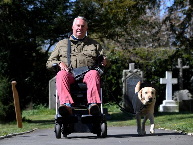 Andrew Newton and his service dog, Alvin, outside St John's Church in Sharrow where his wife is the vicar.