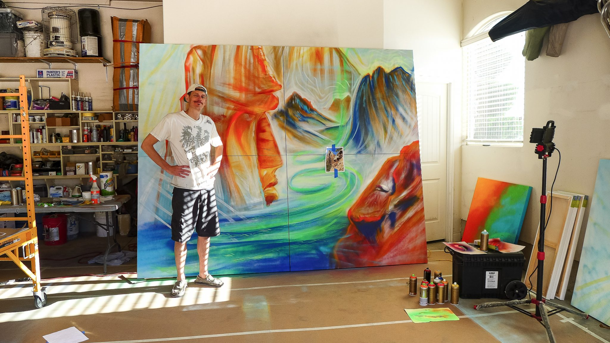 artist mike bowen in front of large painting