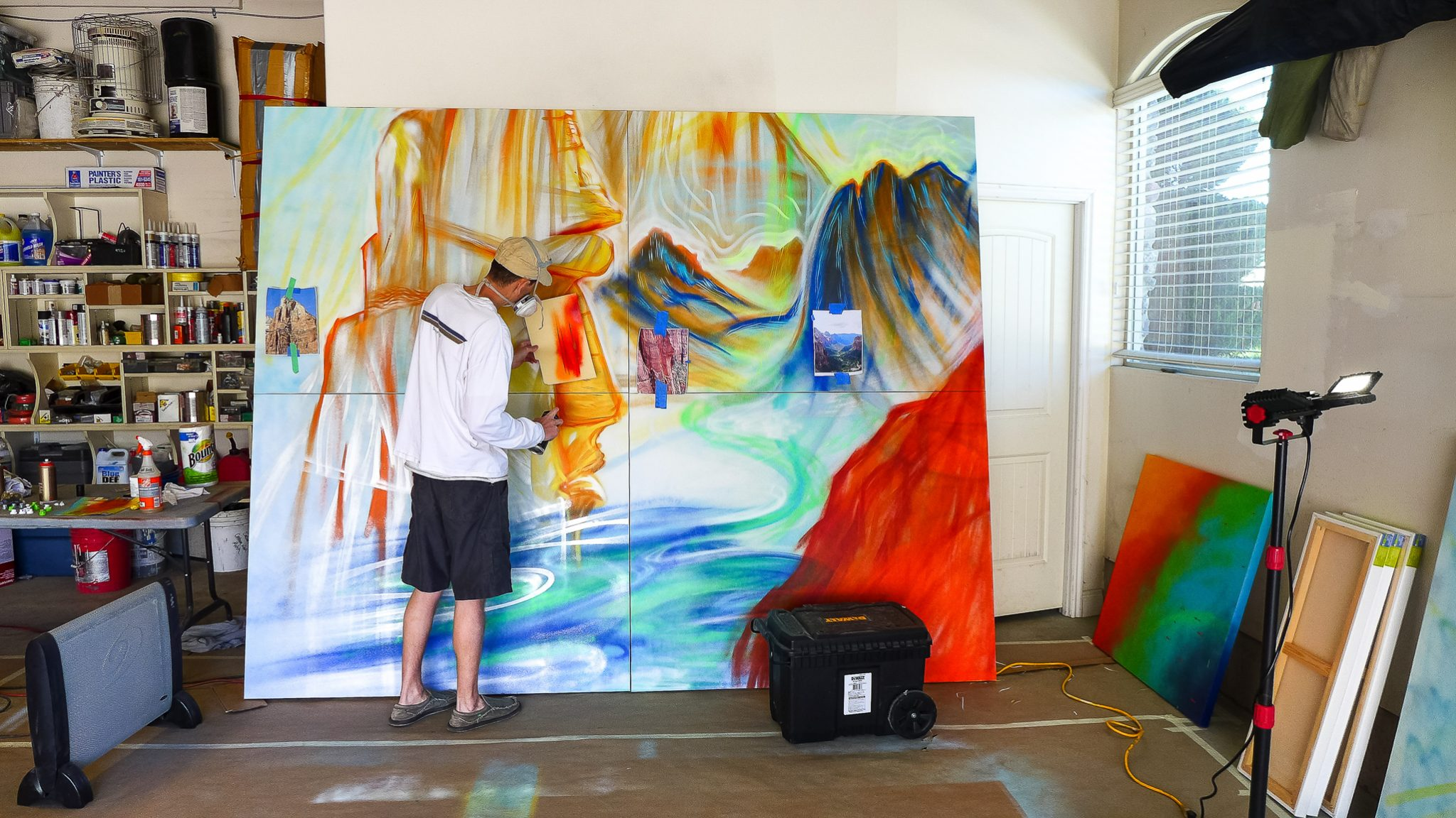 artist mike bowen painting in garage
