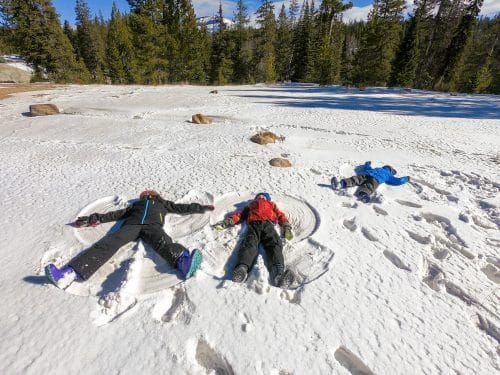 kids making snow angles in the snow