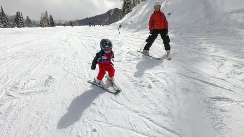 baby skiing with mom