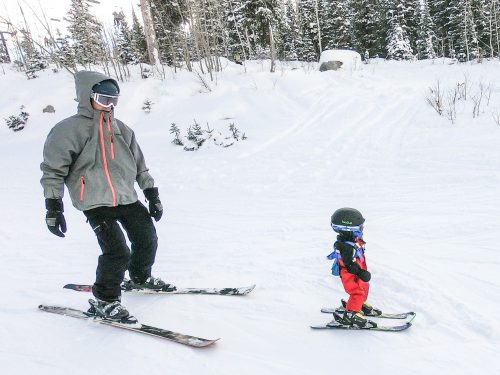 dad and baby skiing