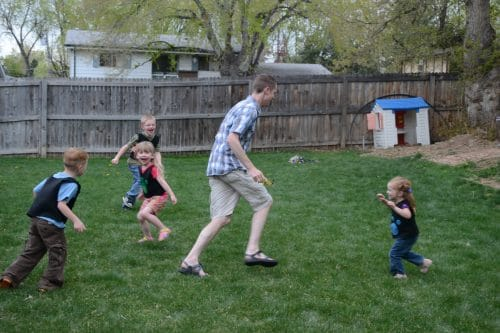 Dad playing outside with kids