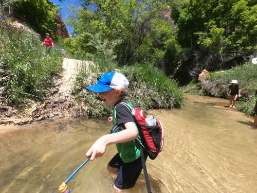 little boy with hydration pack