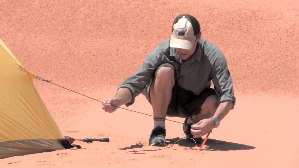 Inserting Tent Stakes in sand