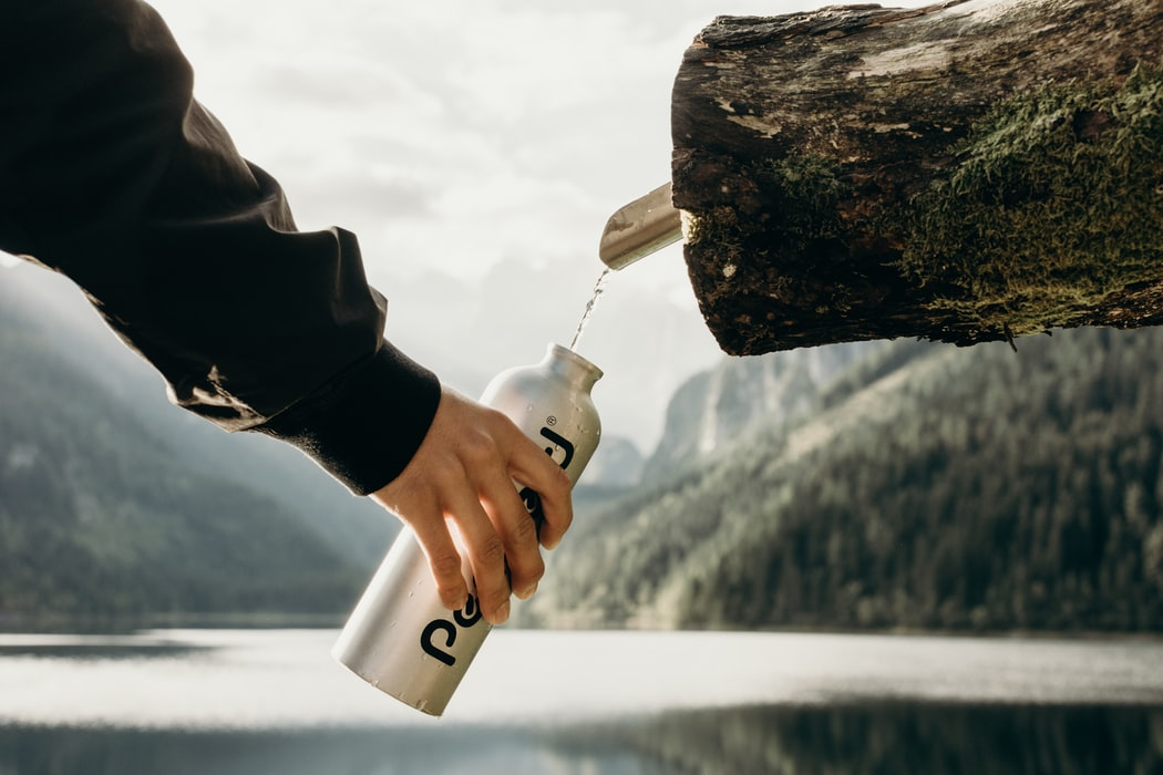 Drink Water From Natural Water Source While Camping
