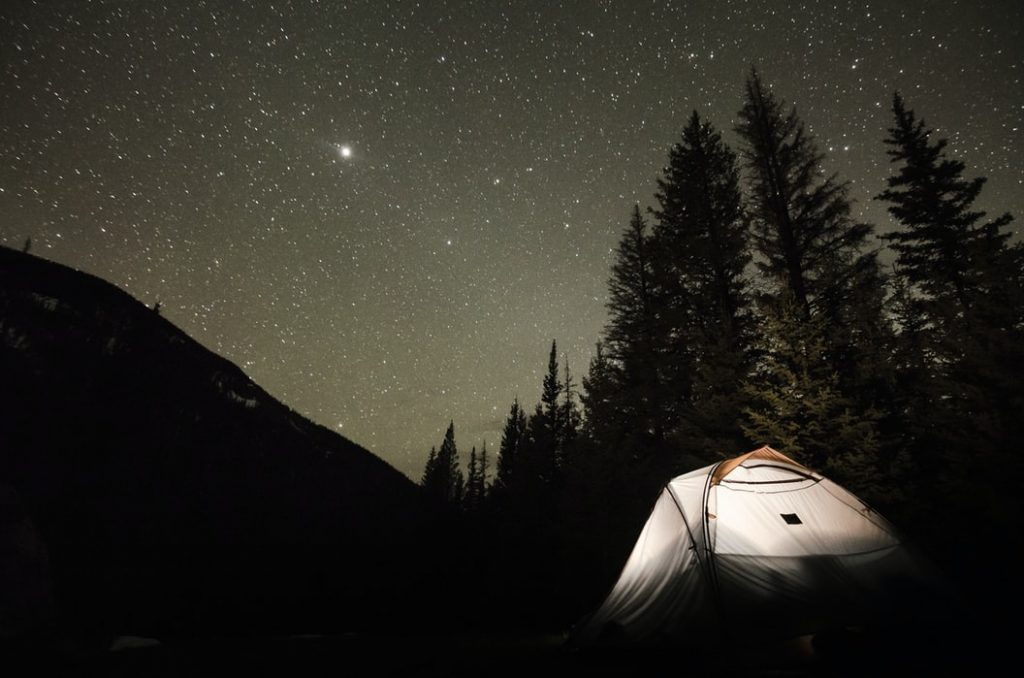 Camping under starry sky