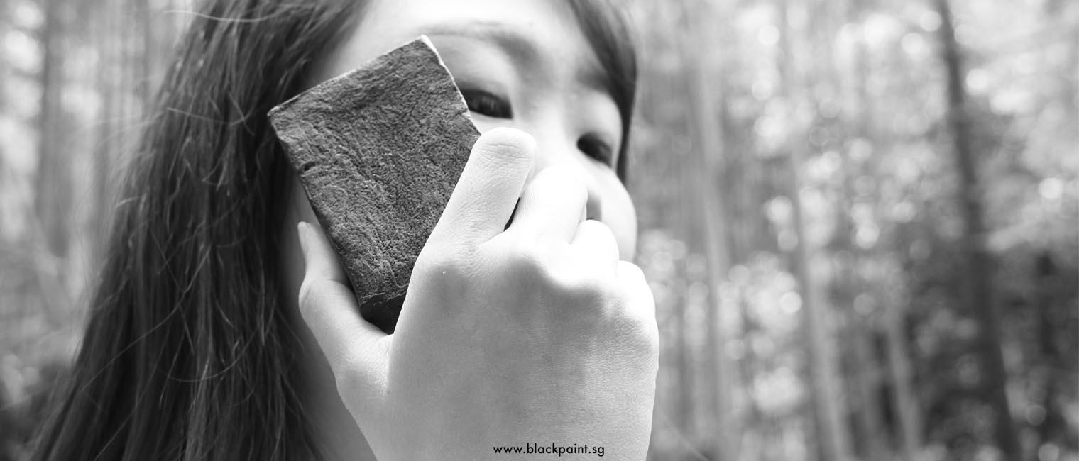 Girl holding Black Paint soap in front of Kyoto bamboo forrest