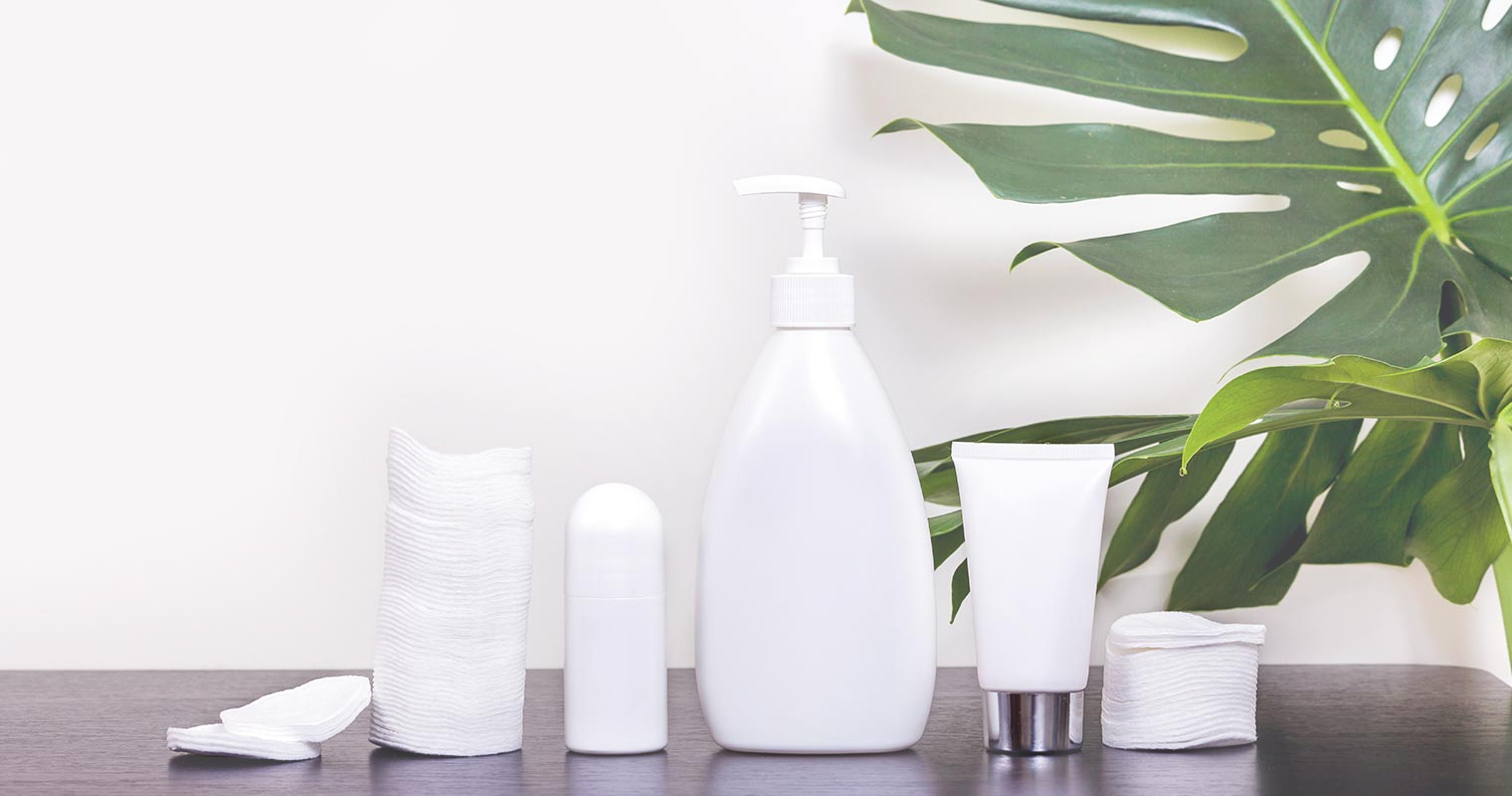 white bottles containing skincare products