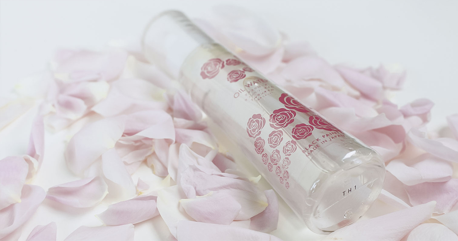 oil water rose bottle with rose petals