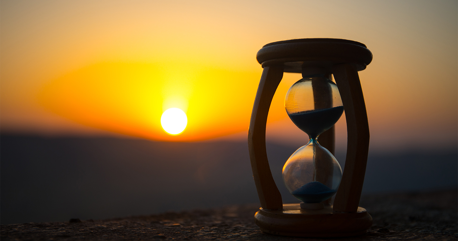 hourglass with sunset